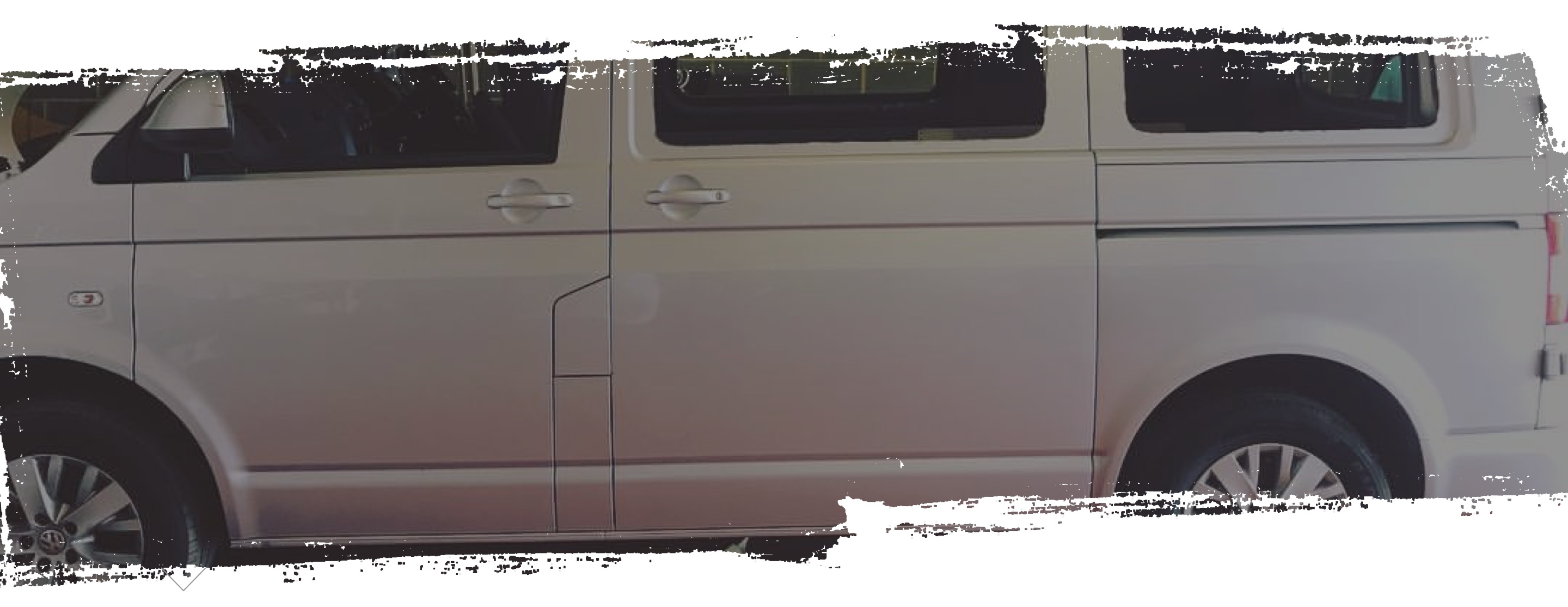 Side profile section of silver campervan