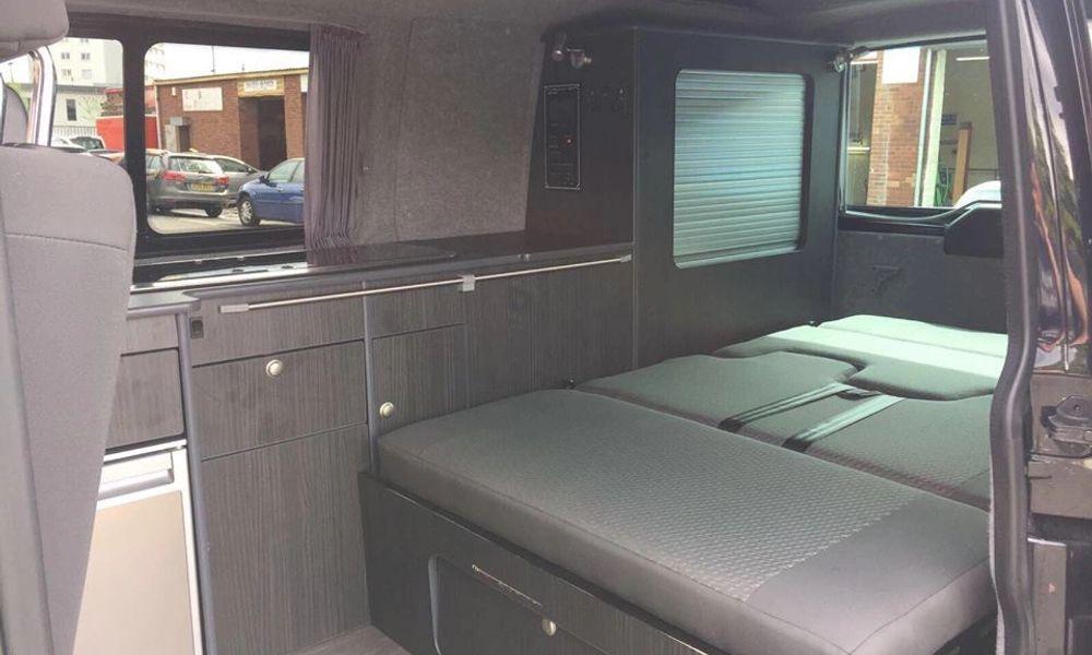 Bed in rear of campervan