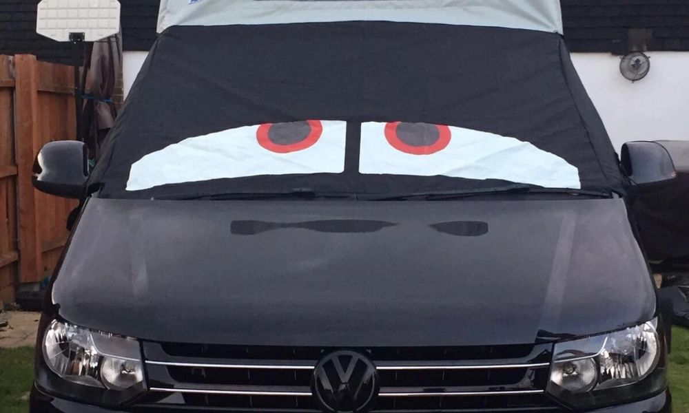 black VW campervan with cover on