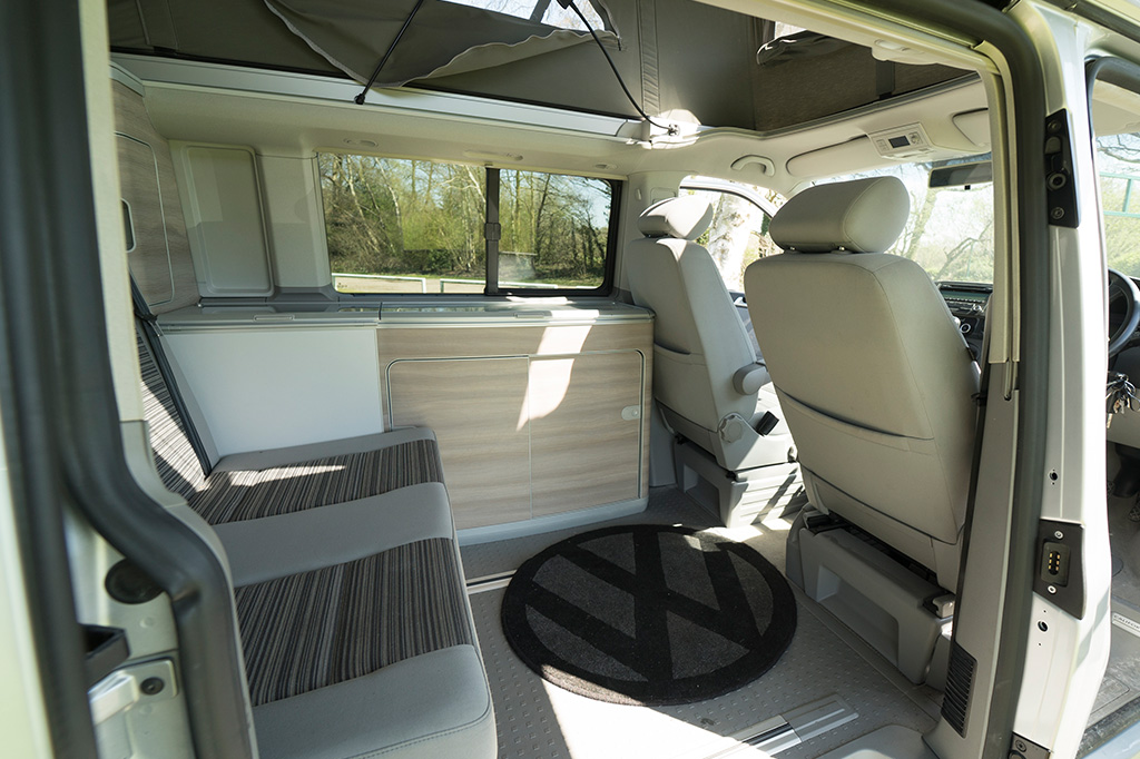 Campervan Interior showing the seats and kitchen area